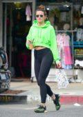 Shantel VanSanten looks amazing in a neon hoodie and black leggings during a coffee run at Alfred's in Studio City, California
