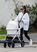 Shay Mitchell takes her daughter for a stroll with a friend in Los Angeles