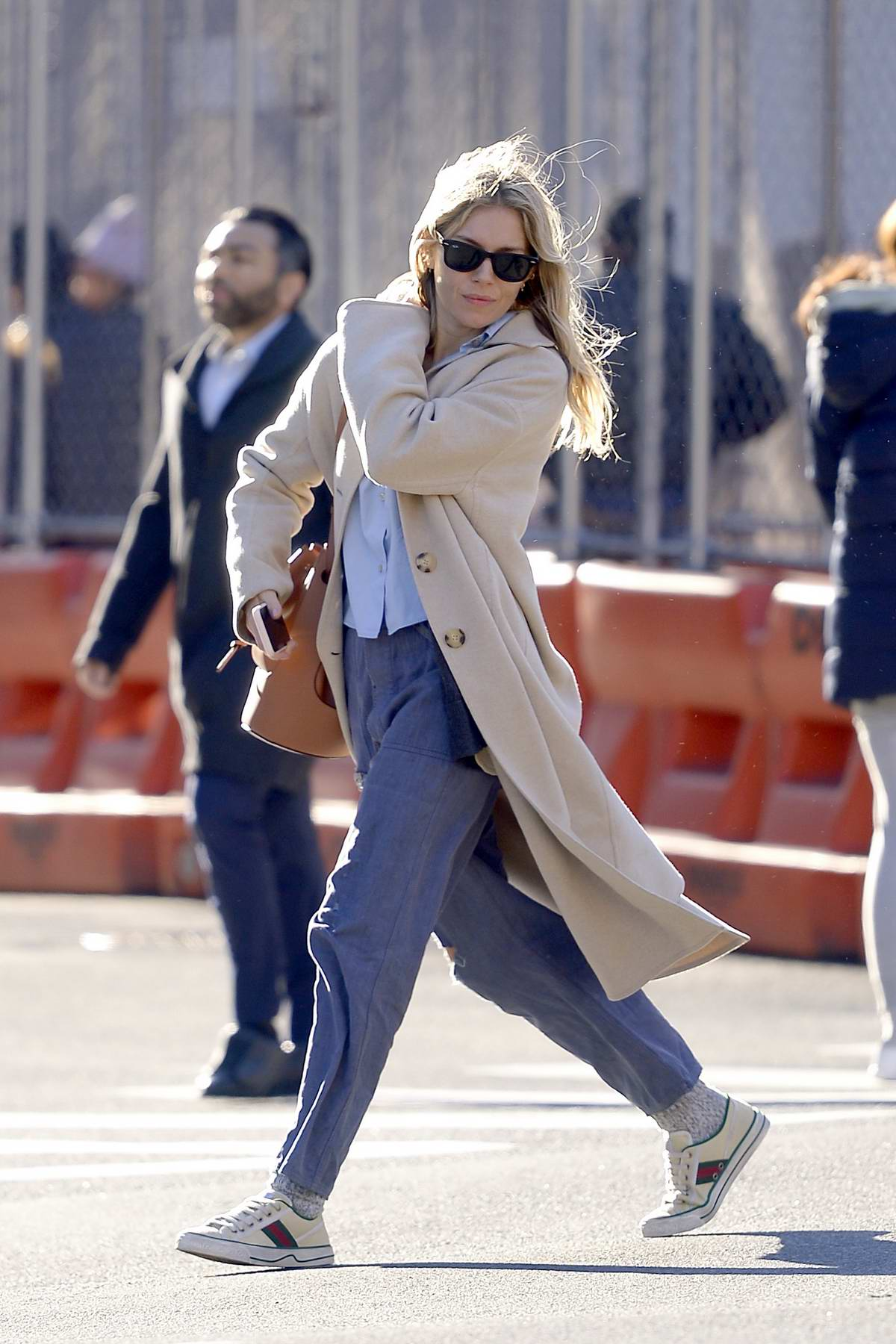 Sienna Miller spotted in a beige trench coat while out running errands in New York City