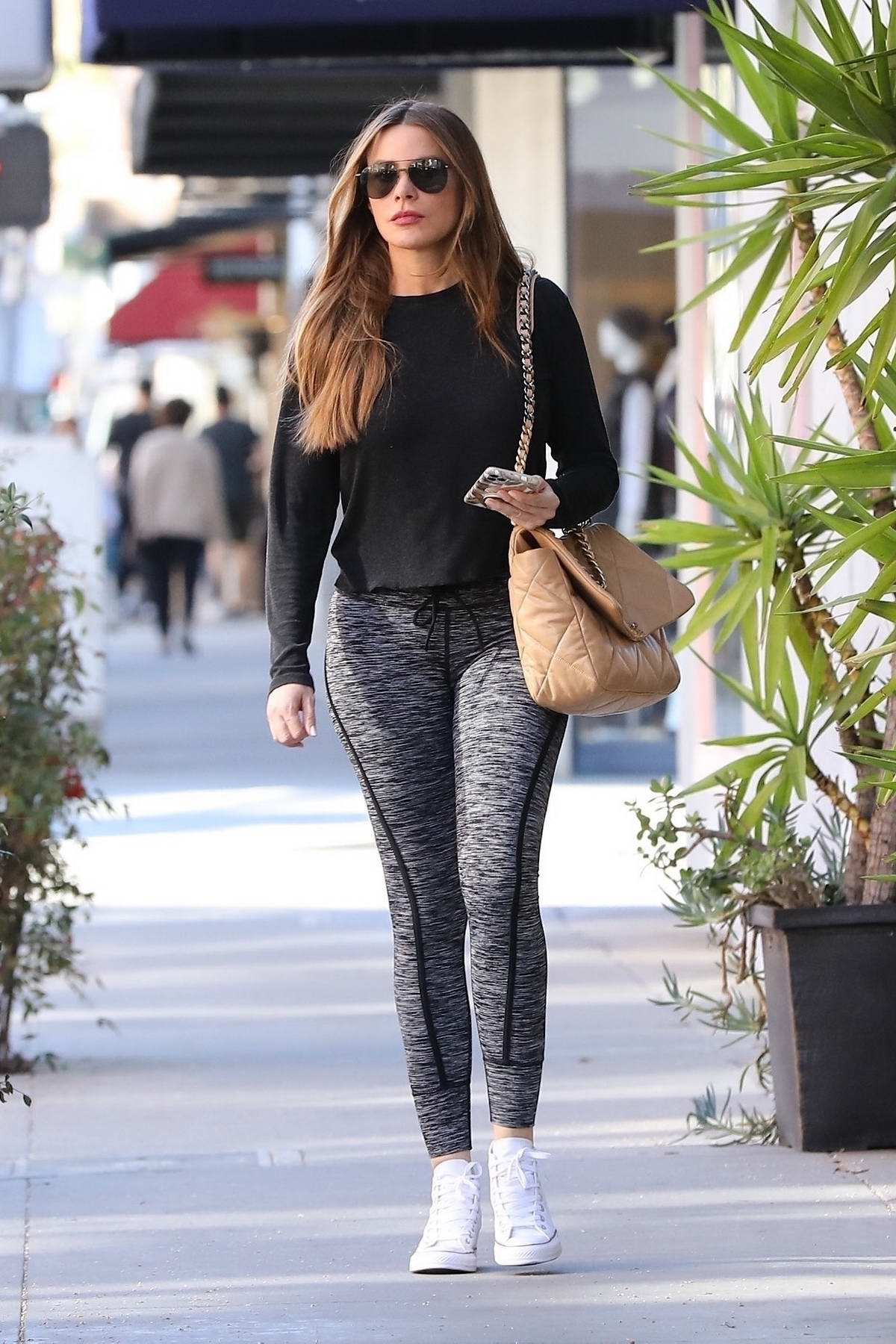 Sofia Vergara looks great in black top and grey leggings while running a few errands in Beverly Hills, California