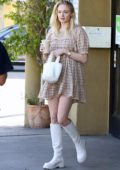 Sophie Turner looks great in a plaid skirt dress and white boots while out for breakfast with Joe Jonas in Los Angeles
