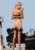 Stella Maxwell seen wearing sheer lingerie during a photoshoot on the beach in Miami, Florida