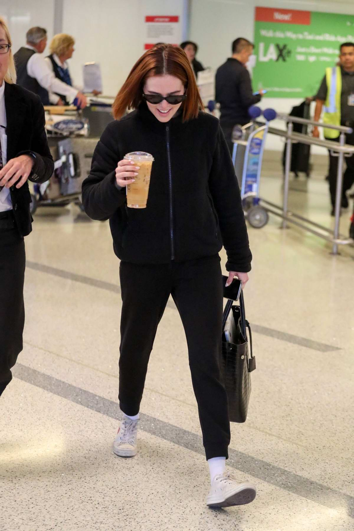 Zoey Deutch dons all-black as she touches down at LAX Airport in Los Angeles