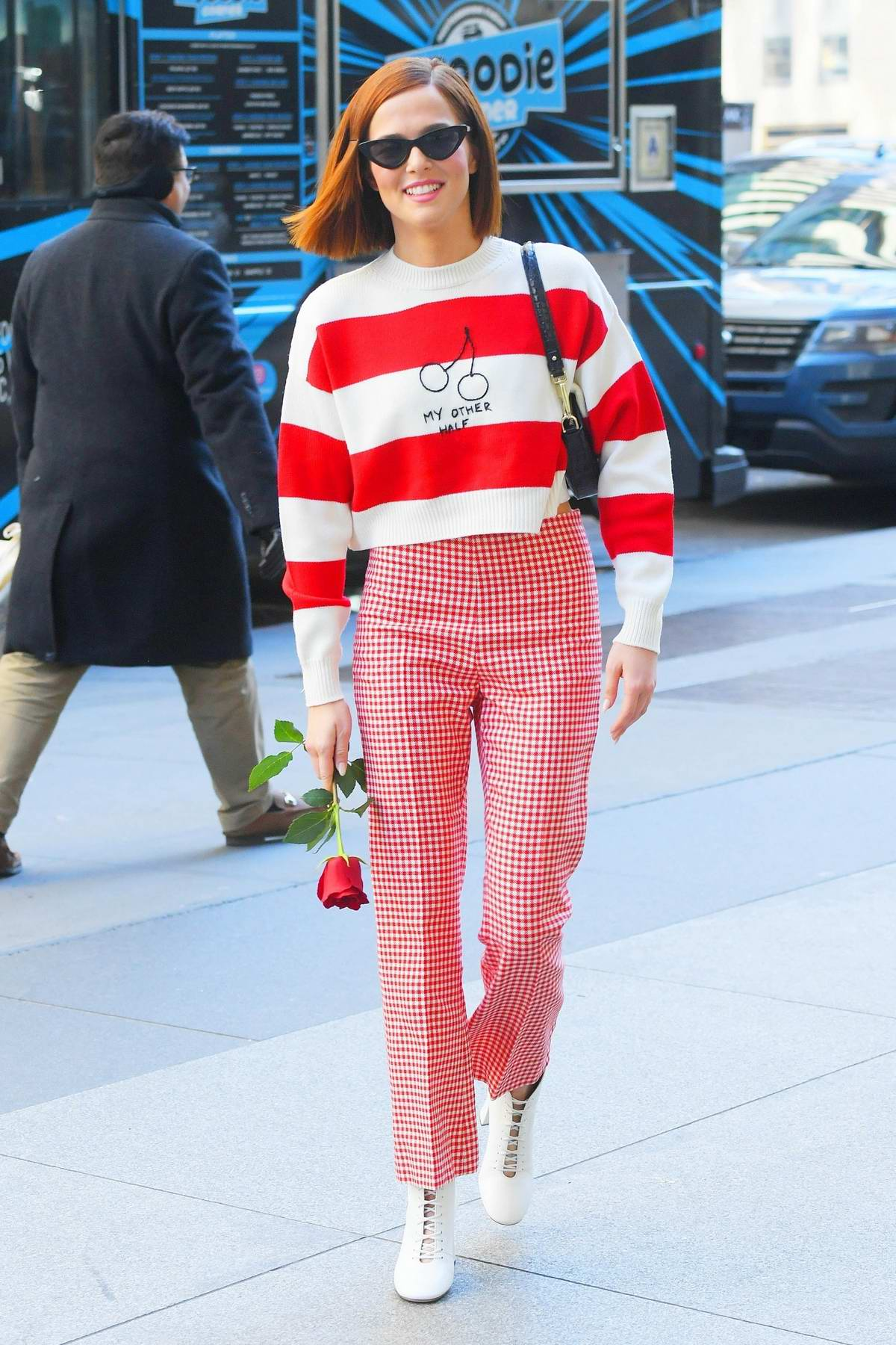 Zoey Deutch wears red and white for Valentine's day as she stops by SiriusXM in New York City