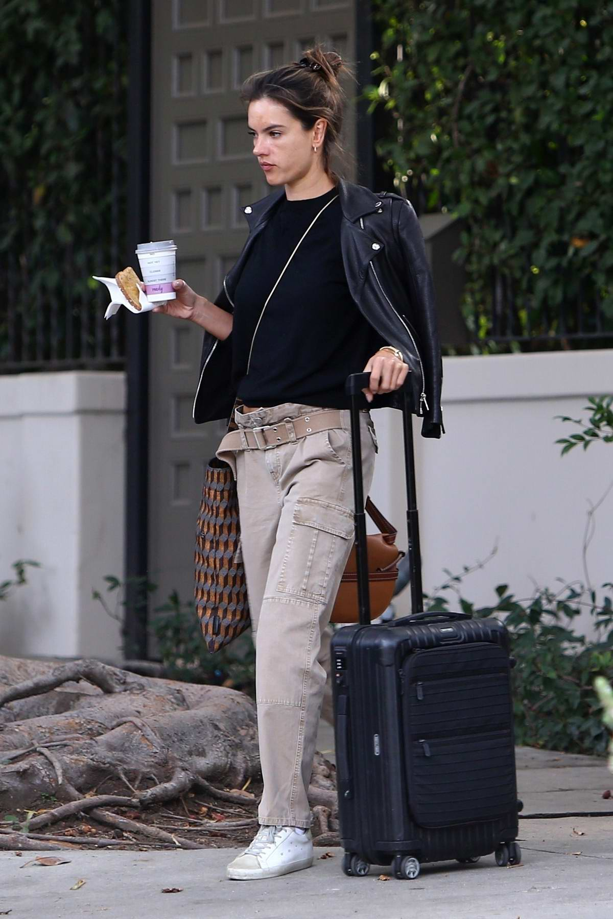 Alessandra Ambrosio grabs coffee and some toast as she heads to LAX, Brentwood, California
