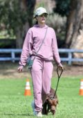Alessandra Ambrosio sports a light plum sweatsuit as she goes hiking with her dog in Pacific Palisades, California