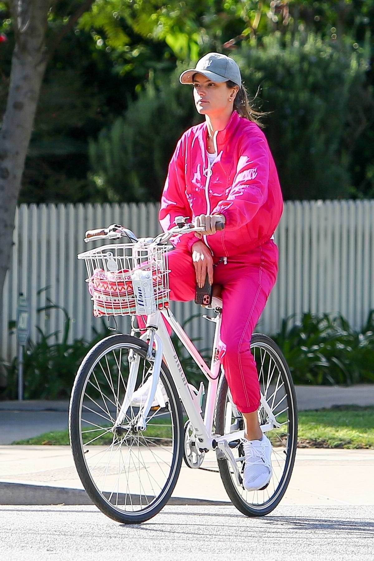 Alessandra Ambrosio spotted in a hot pink tracksuit while out for a bike ride in Santa Monica, California