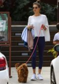 Alessandra Ambrosio steps out to walk her dog with her son Noah in Malibu, California
