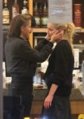 Amber Heard packs on some PDA with Bianca Butti while shopping groceries at at Oaks Gourmet Market in Los Angeles