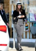 Ana de Armas looks great in a black jacket, skin-tight jeans and a fedora while out shopping at Larchmont Village in Los Angeles