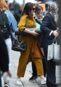 Anne Hathaway carries a Foam Roller while heading out with friends in the Upper West Side, New York City
