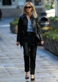 Ashley Roberts seen wearing black leather jacket with matching trousers as she arrives at Global Radio in London, UK