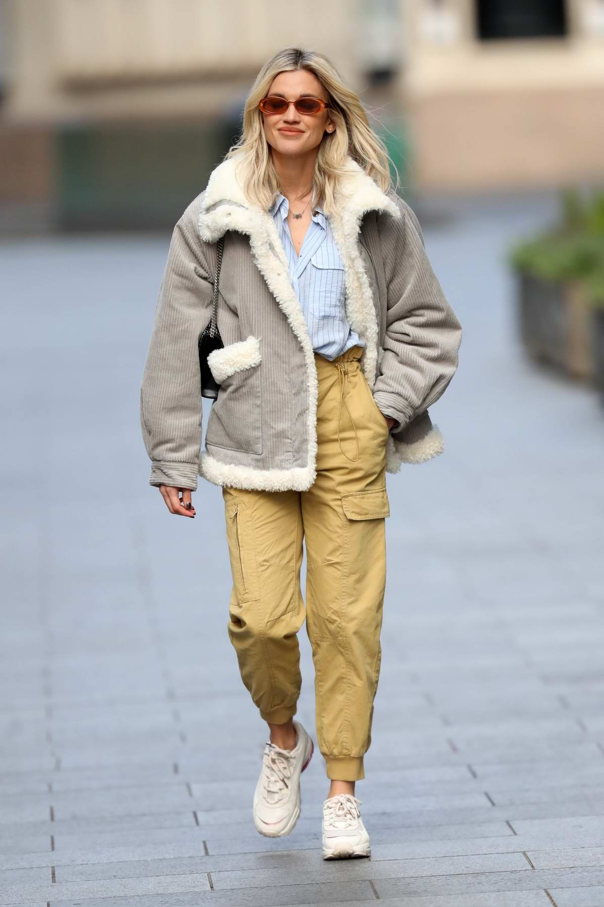 Ashley Roberts wears a grey fur-lined jacket and khaki trousers as she leaves Heart Radio in London, UK