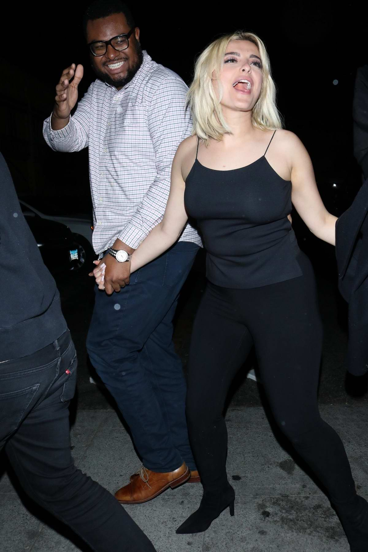 Bebe Rexha is all smiles as she leaves Delilah Nightclub in West Hollywood, California