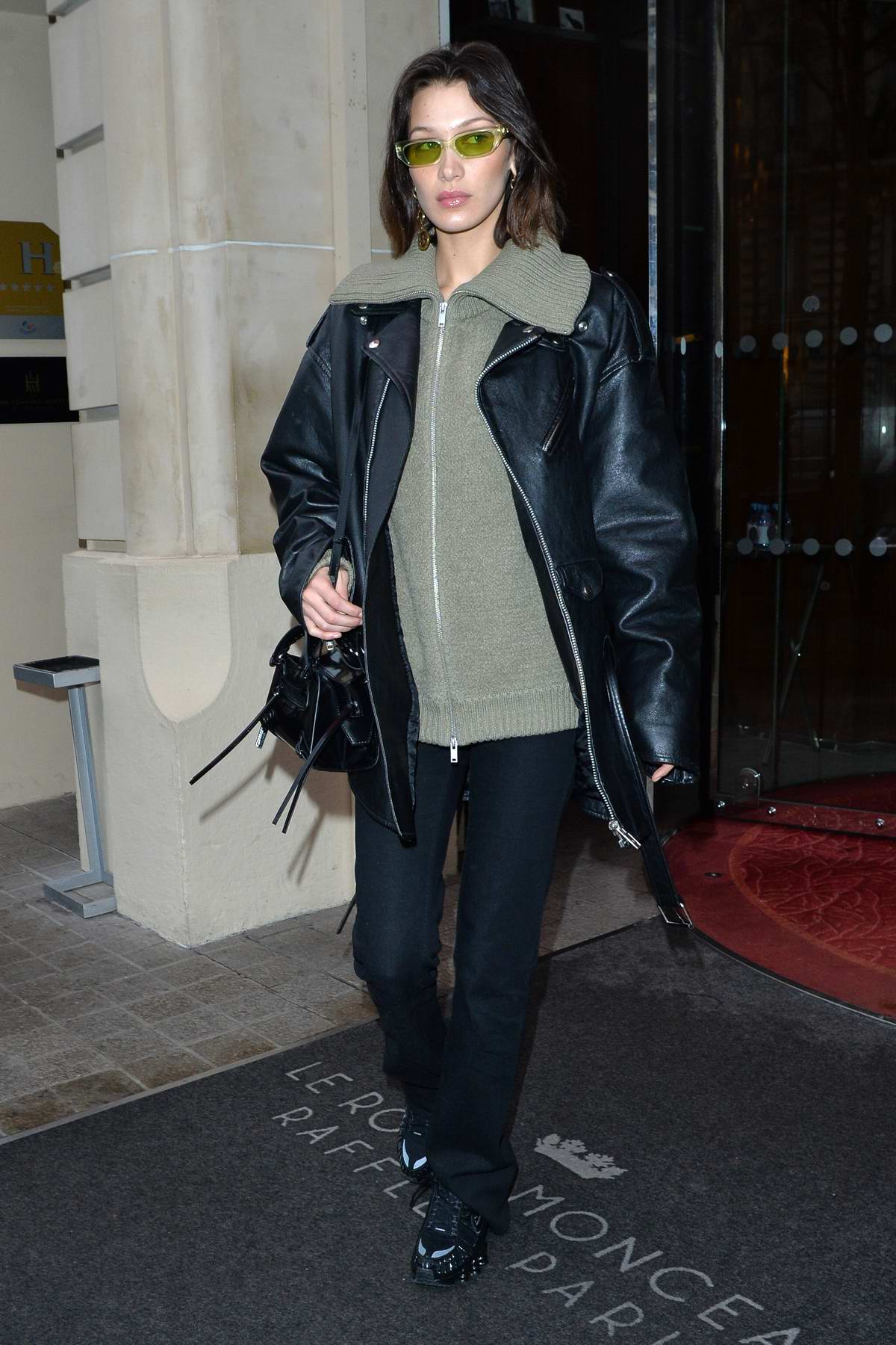 Bella Hadid sports a black leather jacket as she leaves her hotel in Paris, France