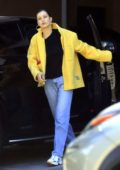Bella Hadid wears a bright yellow fleece jacket while to grab some take out lunch in Los Angeles