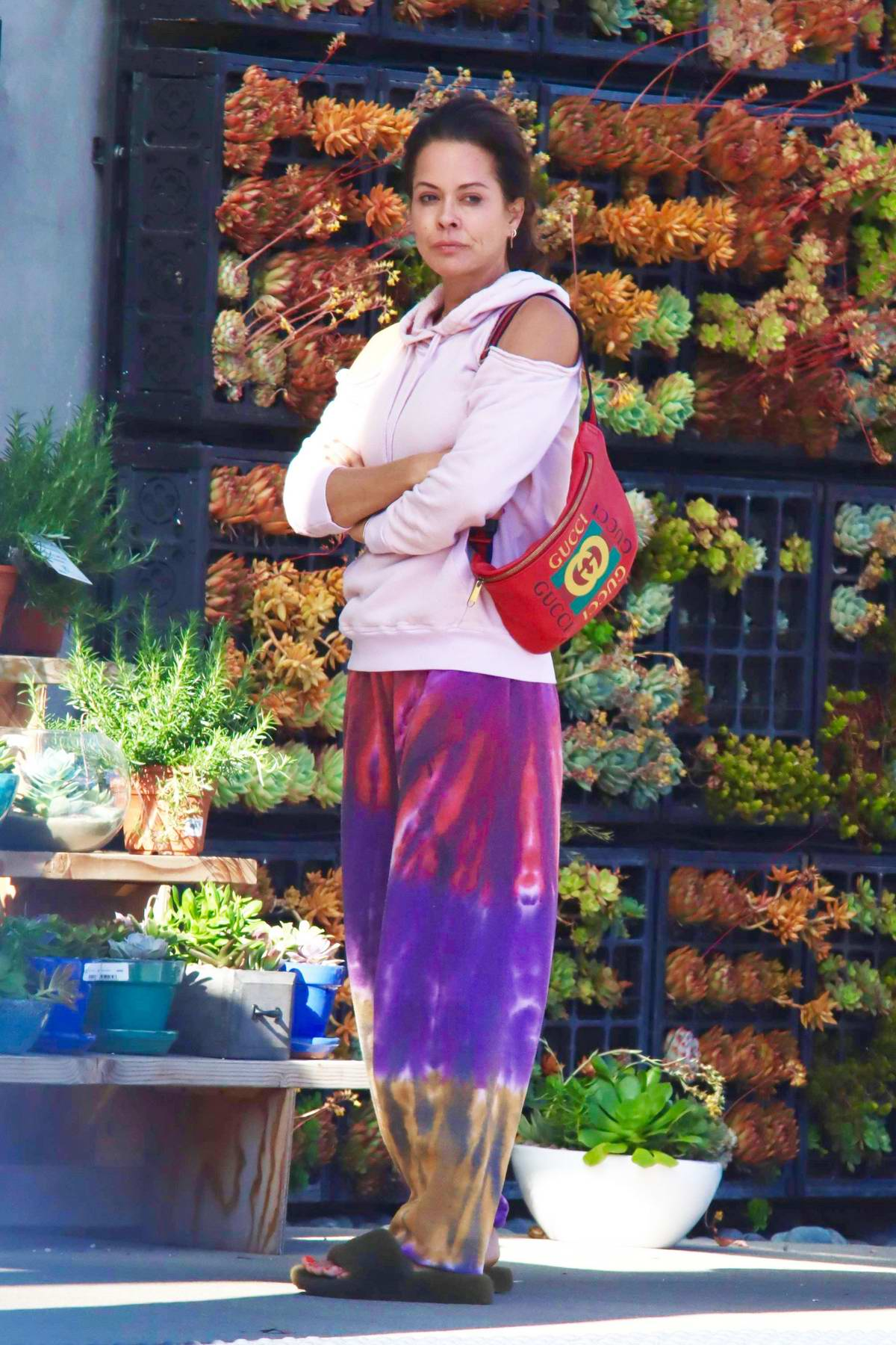 Brooke Burke dons colorful sweatpants while out shopping flowers and groceries in Malibu, California