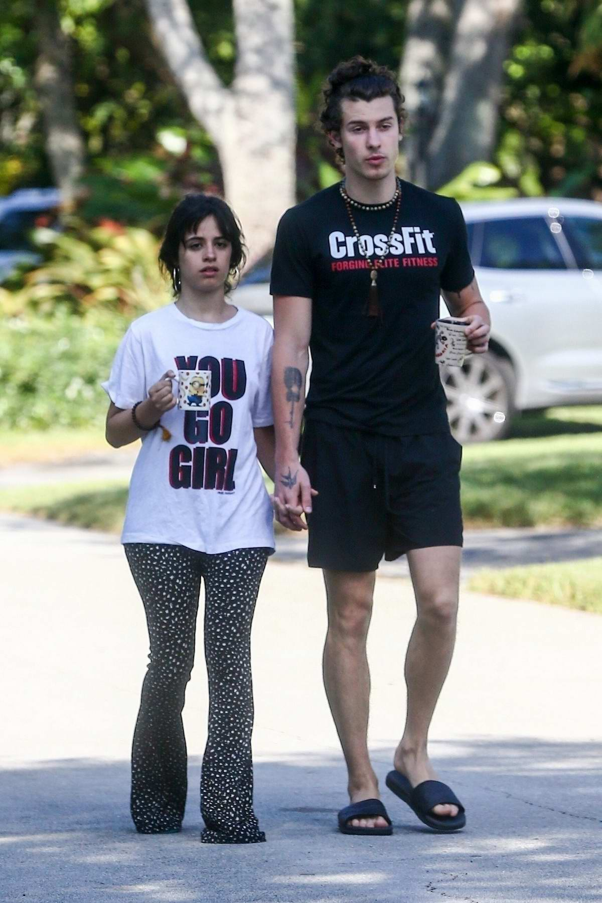 Camila Cabello and Shawn Mendes enjoy their coffee while out for morning walk in Coral Gables, Florida