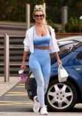 Christine McGuinness flaunts her toned figure in a blue sports bra and leggings as she leaves the gym in Cheshire, UK