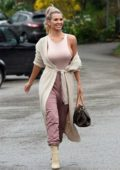 Christine McGuinness looks great in a light pink tank top while out running errands in Alderley Edge, Cheshire, UK