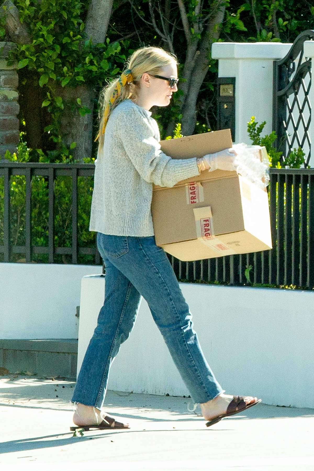 Dakota Fanning takes some stuff to her new home amid 'Stay-at-Home' order in Los Angeles