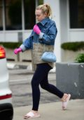 Dakota Fanning wears pink latex gloves while stepping out in Los Angeles