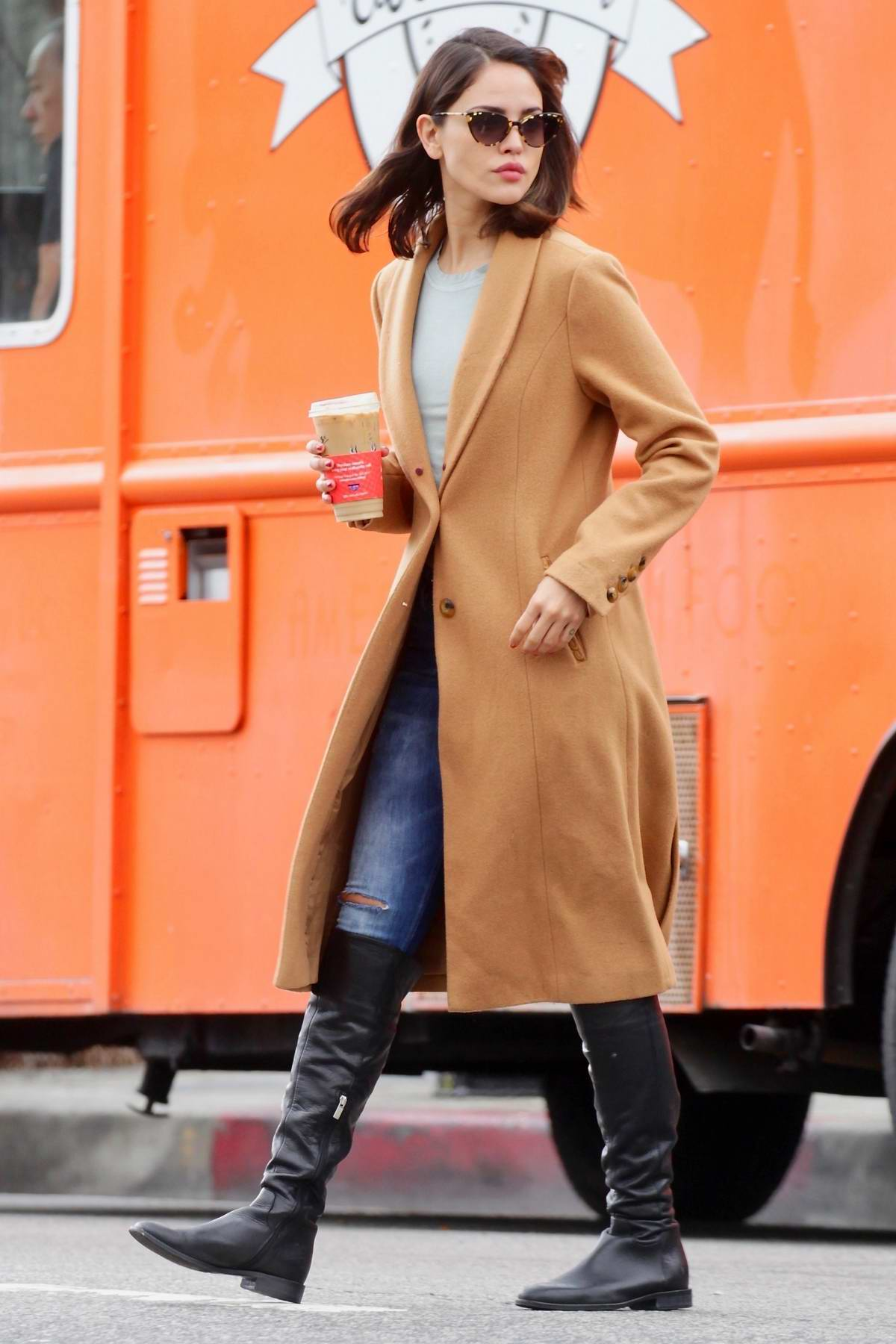 Eiza Gonzalez seen wearing a tan coat while stopping for gas in Los Angeles