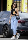 Eiza Gonzalez wears a black crop top and high-waisted jeans while making a coffee run in Los Angeles