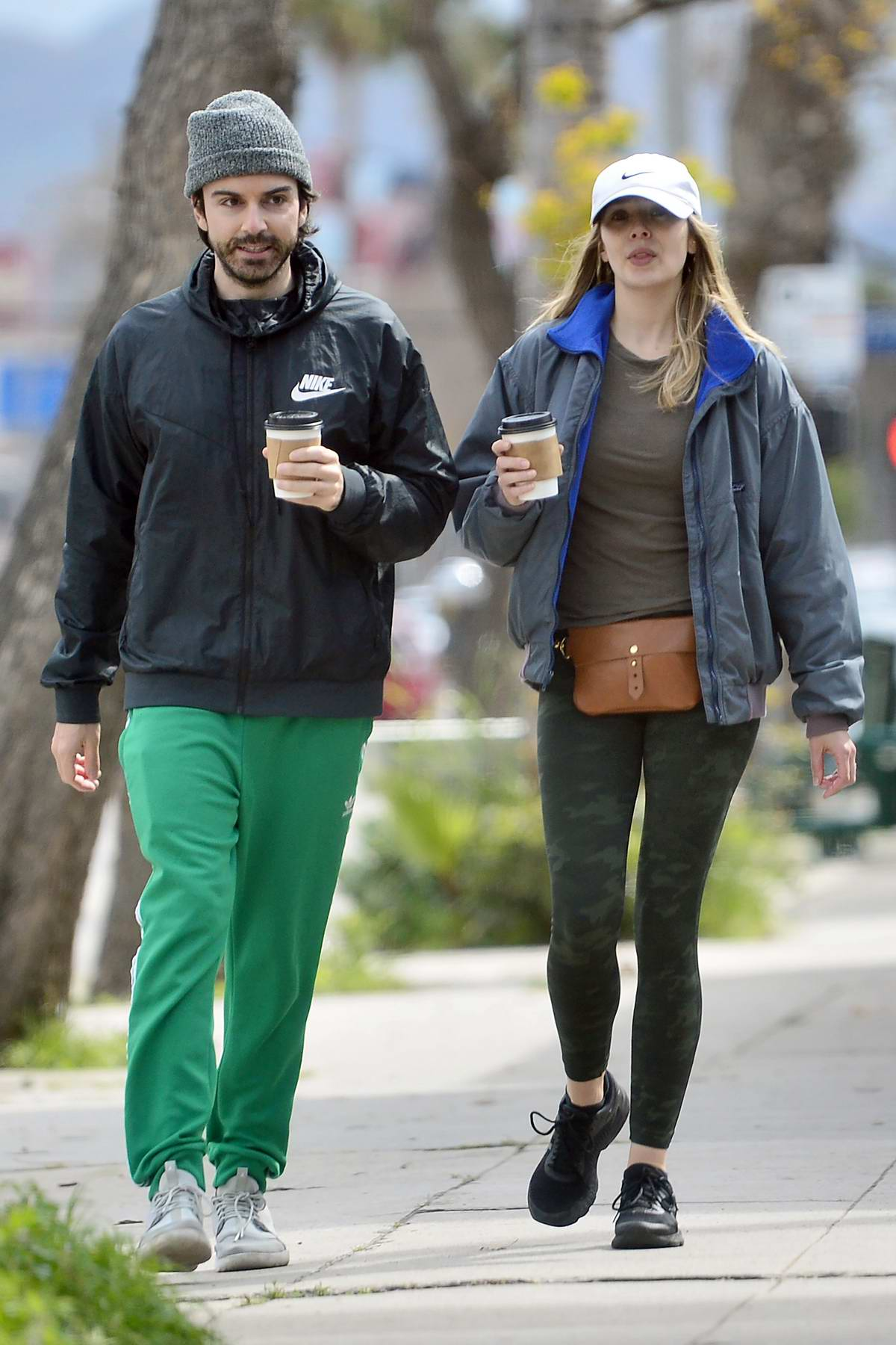 Elizabeth Olsen and Robbie Arnett step out for some coffee while strolling through their neighborhood in Los Angeles