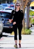 Elizabeth Olsen opts for a black sweater and leggings while stepping out in Los Angeles