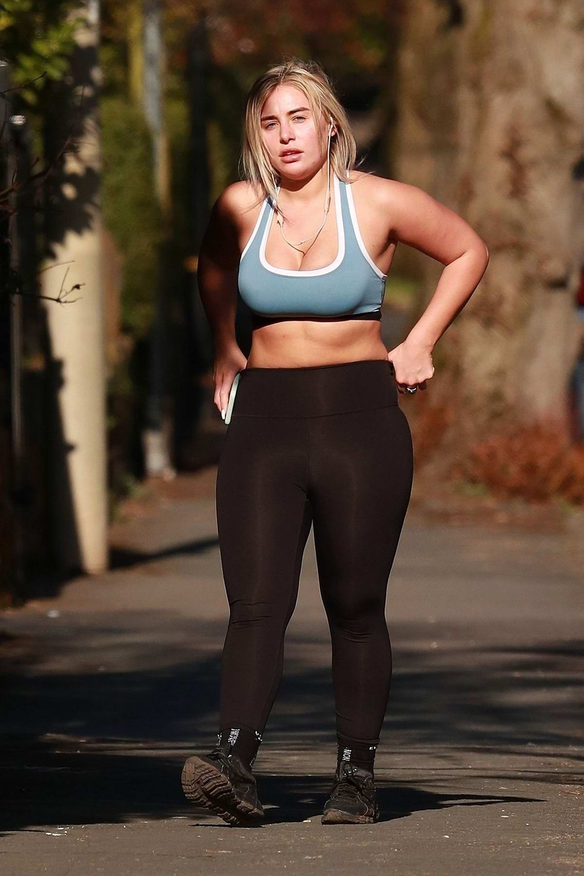 Ellie Brown wears a blue workout top and leggings while out for walk in Cheshire, UK