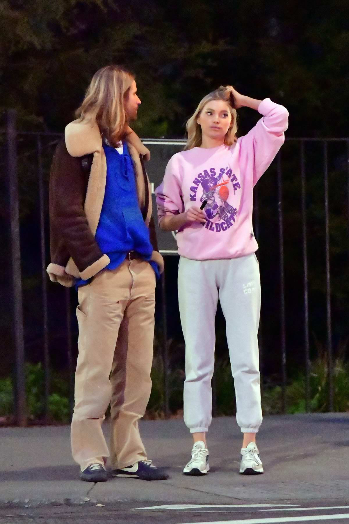 Elsa Hosk wears a pink sweatshirt and grey sweatpants for a stroll with boyfriend Tom Daly in New York City