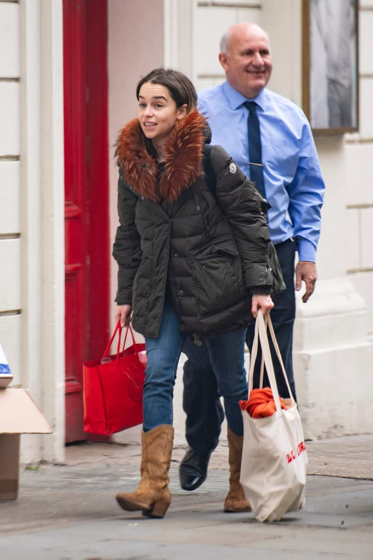 Emilia Clarke bundles up in a fur-lined coat as she steps out in London, UK