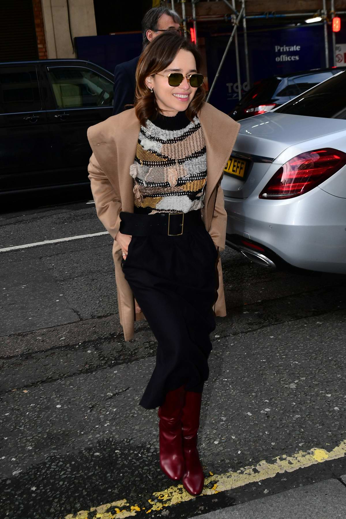 Emilia Clarke is all smiles as she arrives at Radio 2 in London, UK
