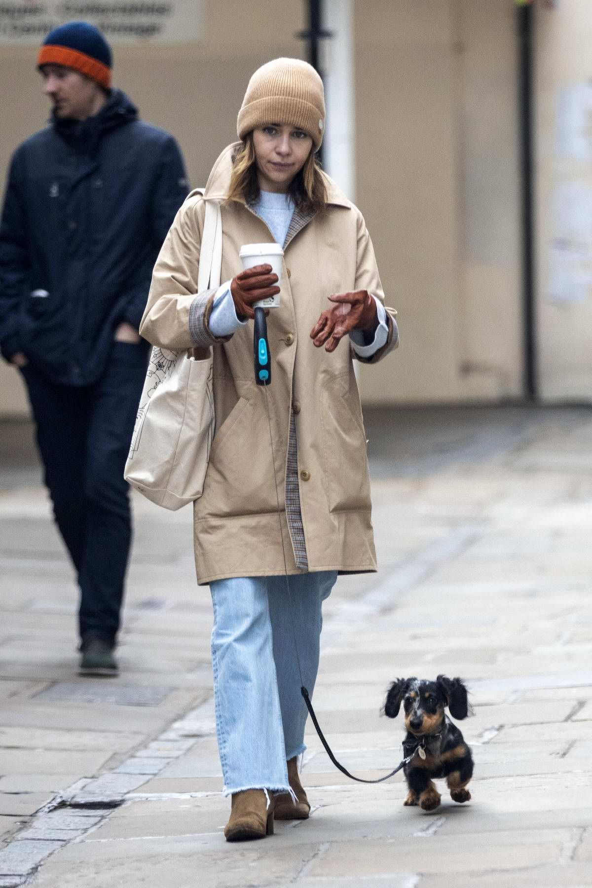 Emilia Clarke takes her dog for a stroll as she steps out for a coffee in London, UK