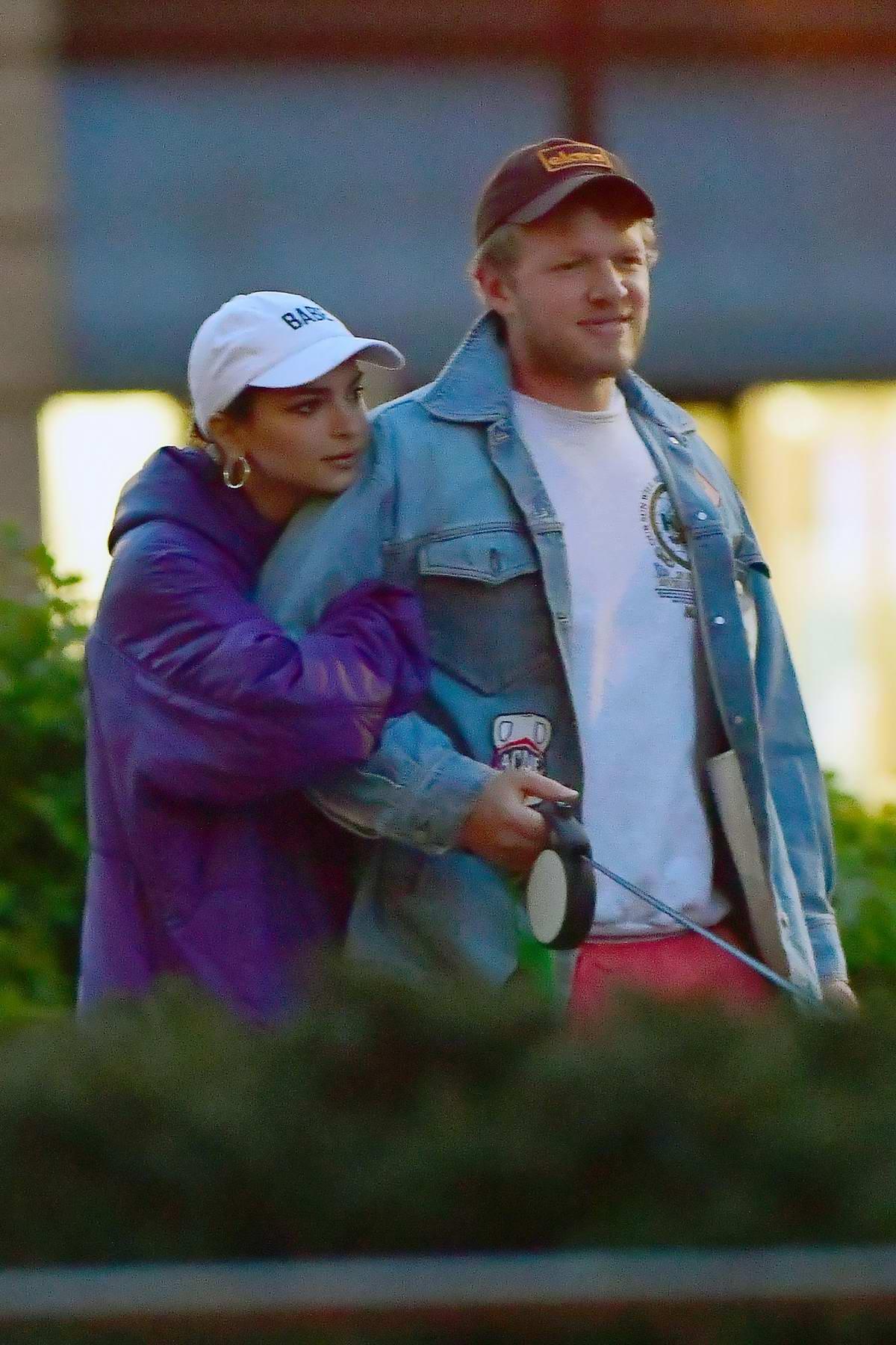 Emily Ratajkowski and Sebastian Bear-McClard keep close as they walk their dog in New York City