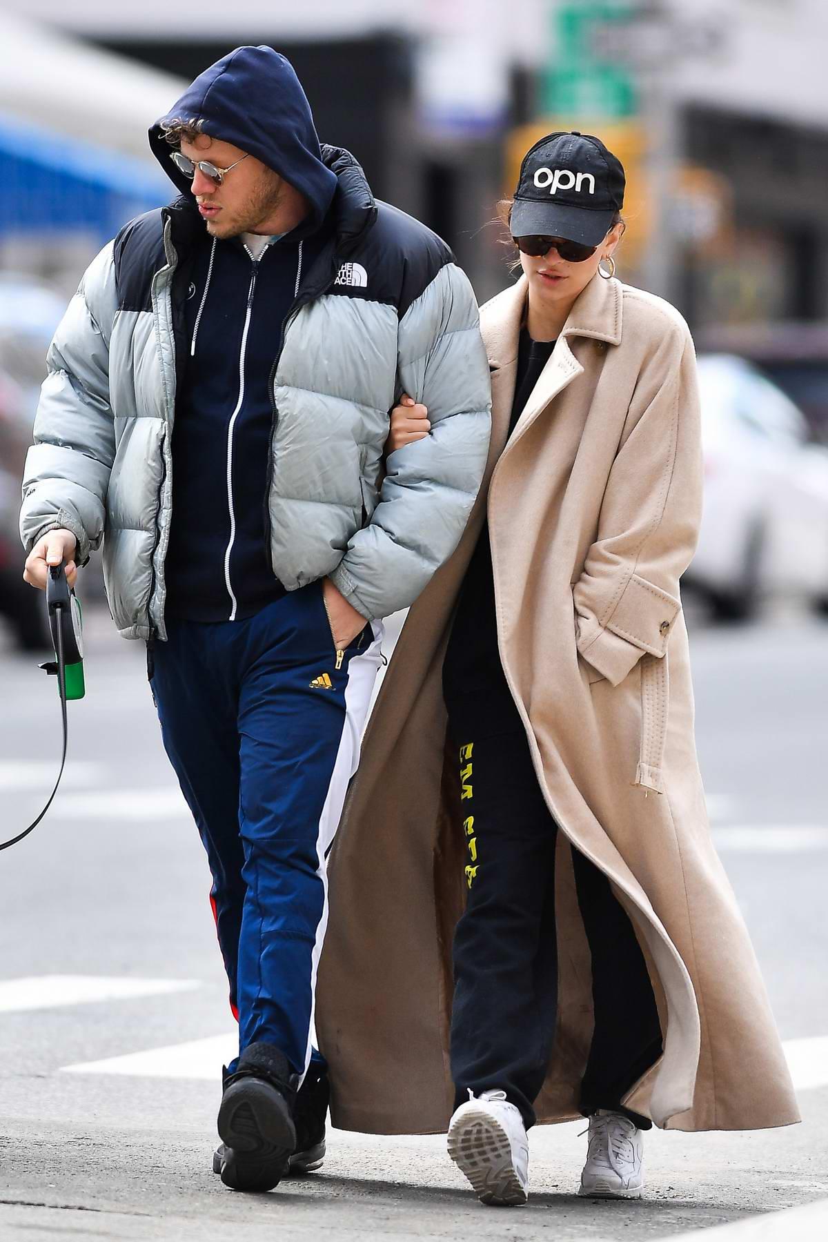 Emily Ratajkowski and Sebastian Bear-McClard walk their dog Colombo in New York City