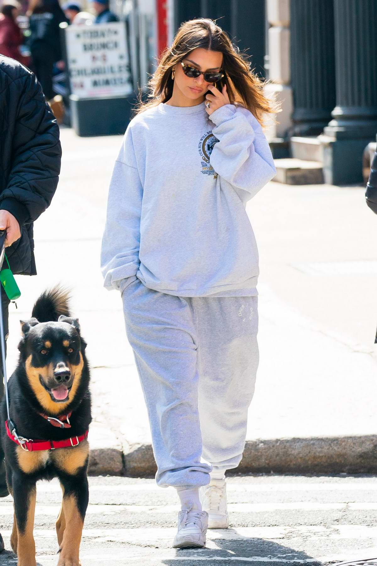 Emily Ratajkowski keeps cozy in a sweatsuit while out with Sebastian Bear-McClard and their dog in New York City