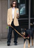 Emily Ratajkowski looks stylish in a beige blazer while out to walk her dog in New York City