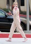 Emma Roberts looks cute in a beige jumpsuit and pink purse while out shopping with her mother in Burbank, California