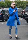 Emma Roberts looks striking in a bright blue coat while out looking at rescue cats in Los Angeles