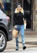 Emma Roberts wears a black top and jeans while out for more grocery shopping in Los Angeles