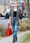 Emma Roberts wears checkered blazer and jeans while heading to a meeting in Beverly Hills, California