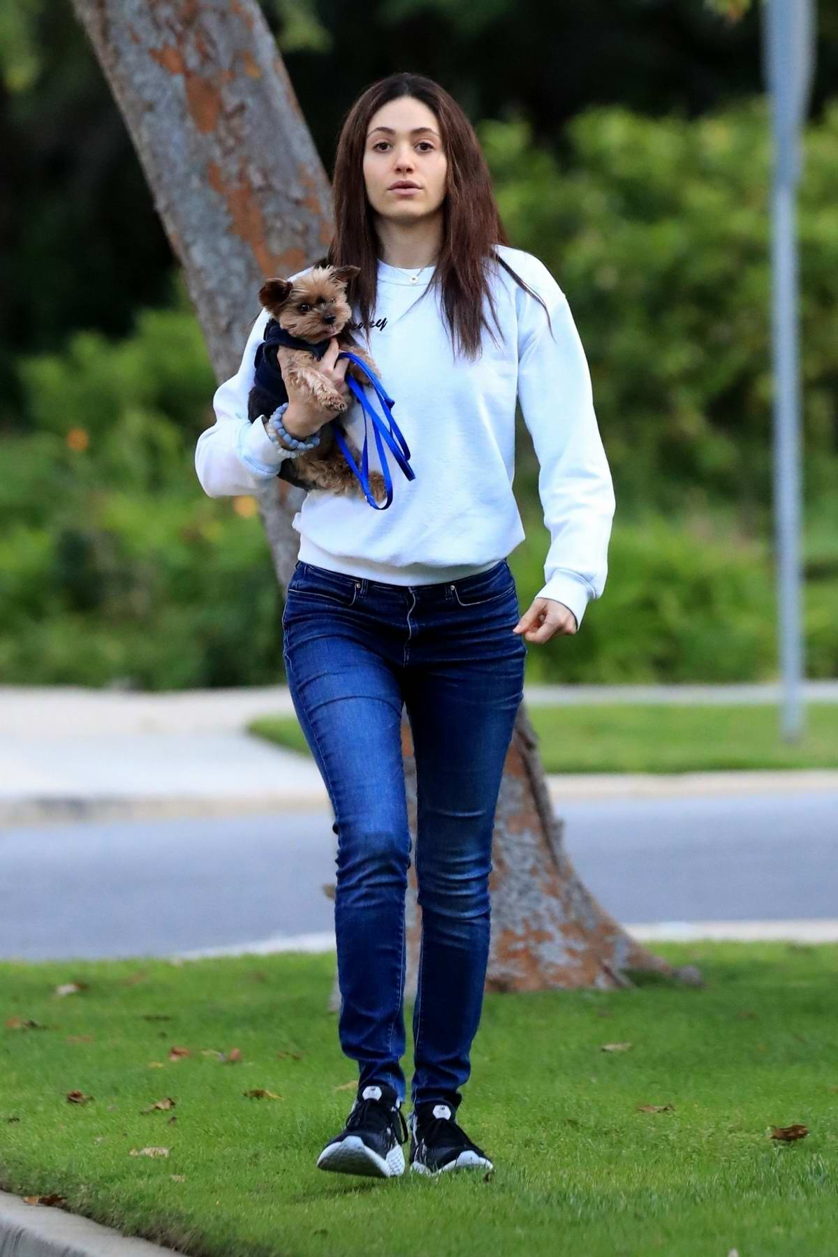 Emmy Rossum and Sam Esmail take their pups for an evening walk in Los Angeles