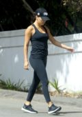 Eva Longoria wears a black tank top and leggings as she steps out for a quick workout in Los Angeles