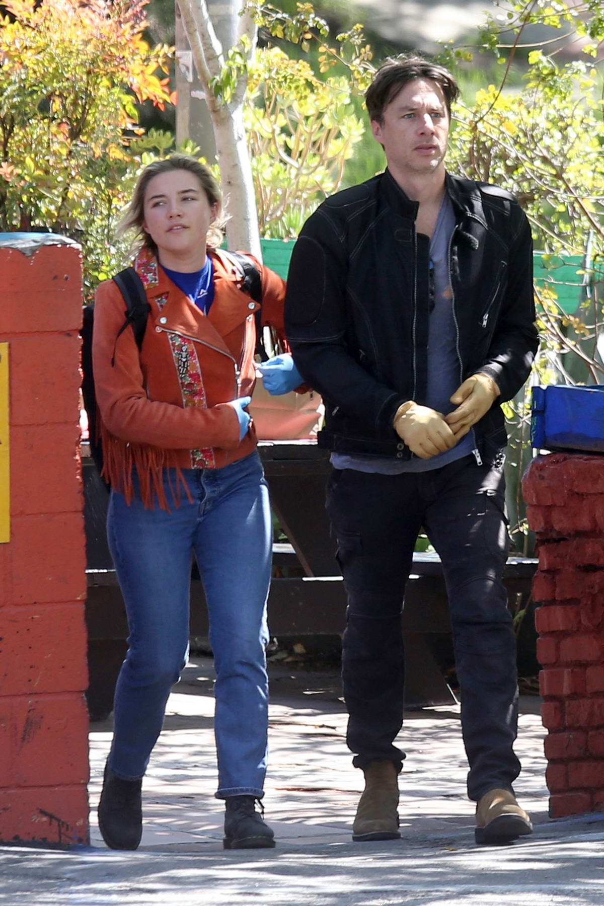 Florence Pugh wears blue latex gloves while out with boyfriend Zach Braff in Los Angeles