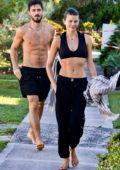 Georgia Fowler shows off her toned midriff as she heads to beach with boyfriend Nathan Dalah in Bondi, Australia