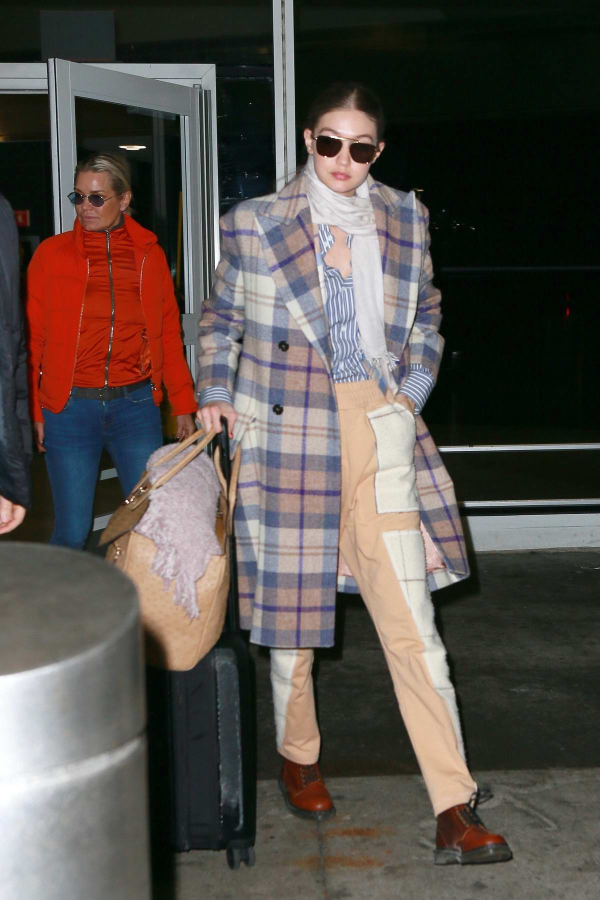 Gigi Hadid and Yolanda Hadid spotted as she they touch down at JFK airport in New York City