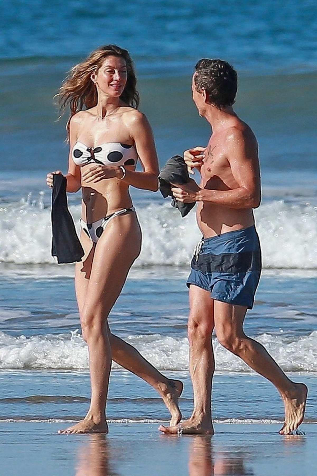 Gisele Bundchen hits the beach in a polka dot bikini during her vacation in Costa Rica