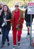 Gwen Stefani seen wearing a bright red jumpsuit and Gucci sneakers while running errands in Los Angeles